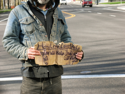 Homeless man holding sign