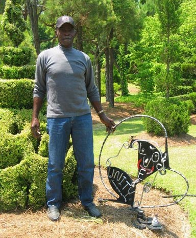 Fryar Stands Beside His Love & Unity Sculpture