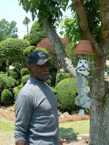 Fryar Shows Off His Pot Head Hanging Sculpture