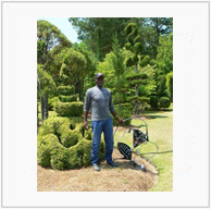 Pearl Fryar with His Love and Unity Sculpture